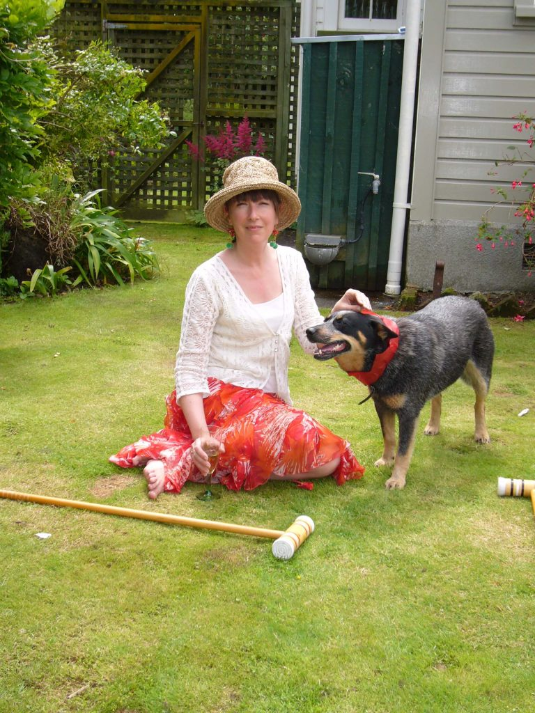 Carole and Mollie playing croquet