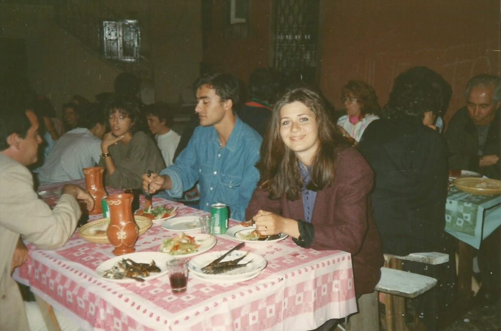 People enjoying grilled sardines in Lisbon