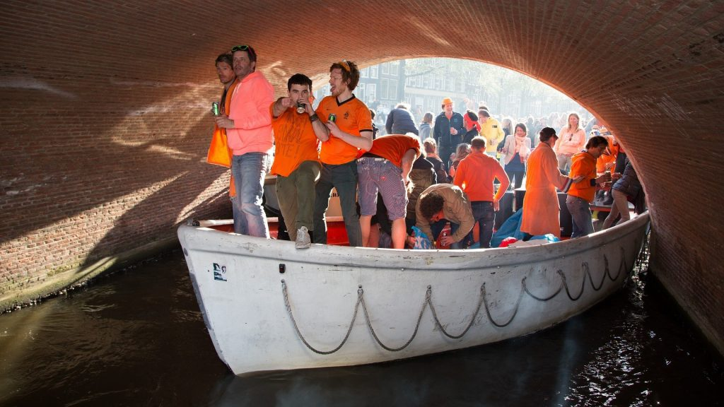 Queen's Day in Amsterdam - revellers on a boat