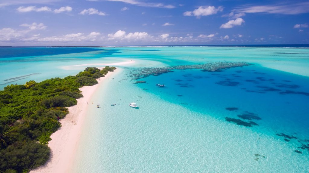Aerial view of tropical island and turquoise waters on beach