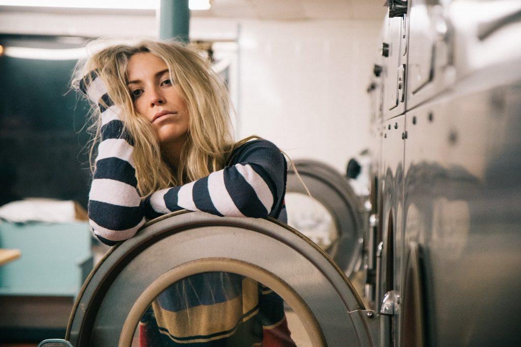 Bored girl in launderette
