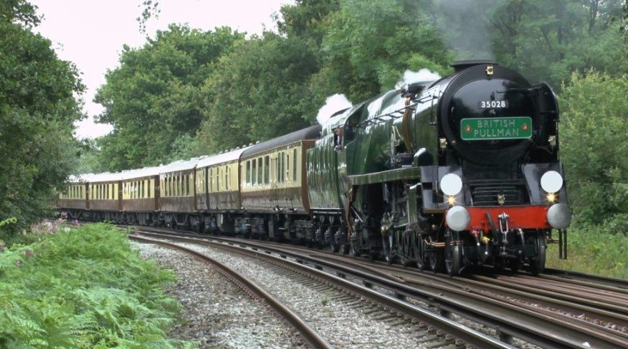 British Pullman train travelling through the English countryside