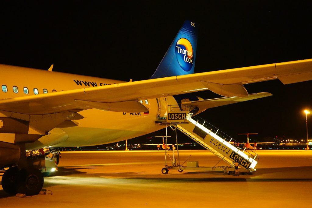 Thomas Cook aircraft parked up at airport gate at night