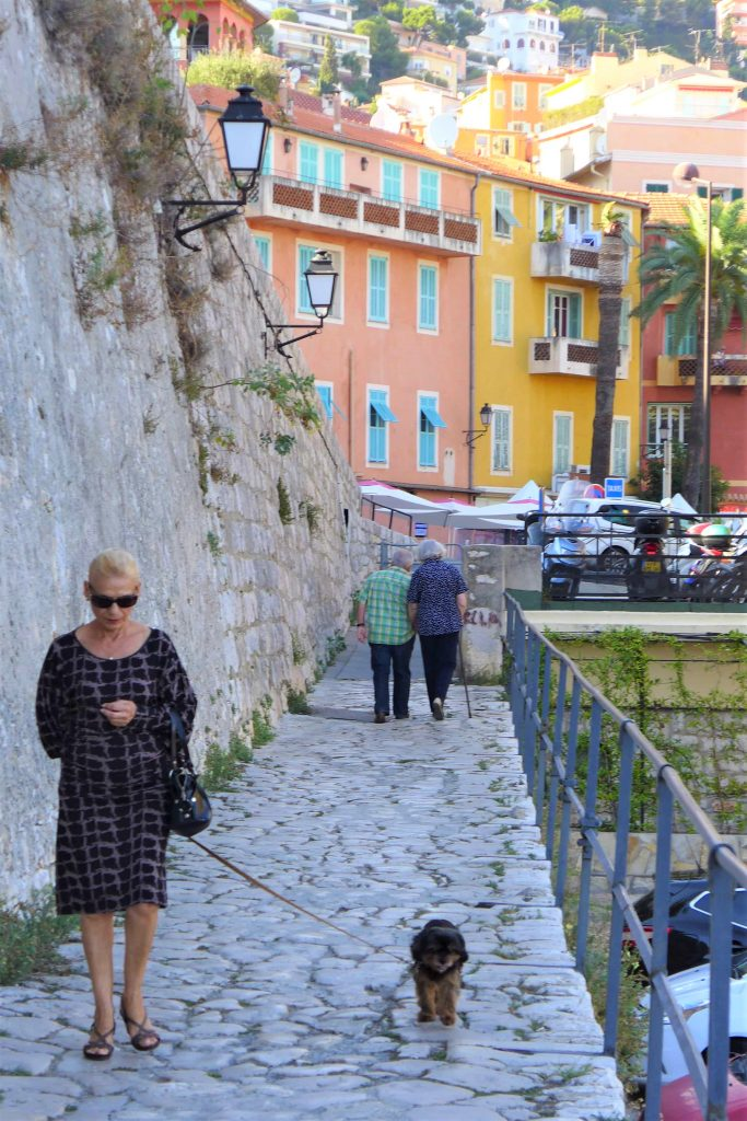 A lady walking her dog in Villefranche sur mer