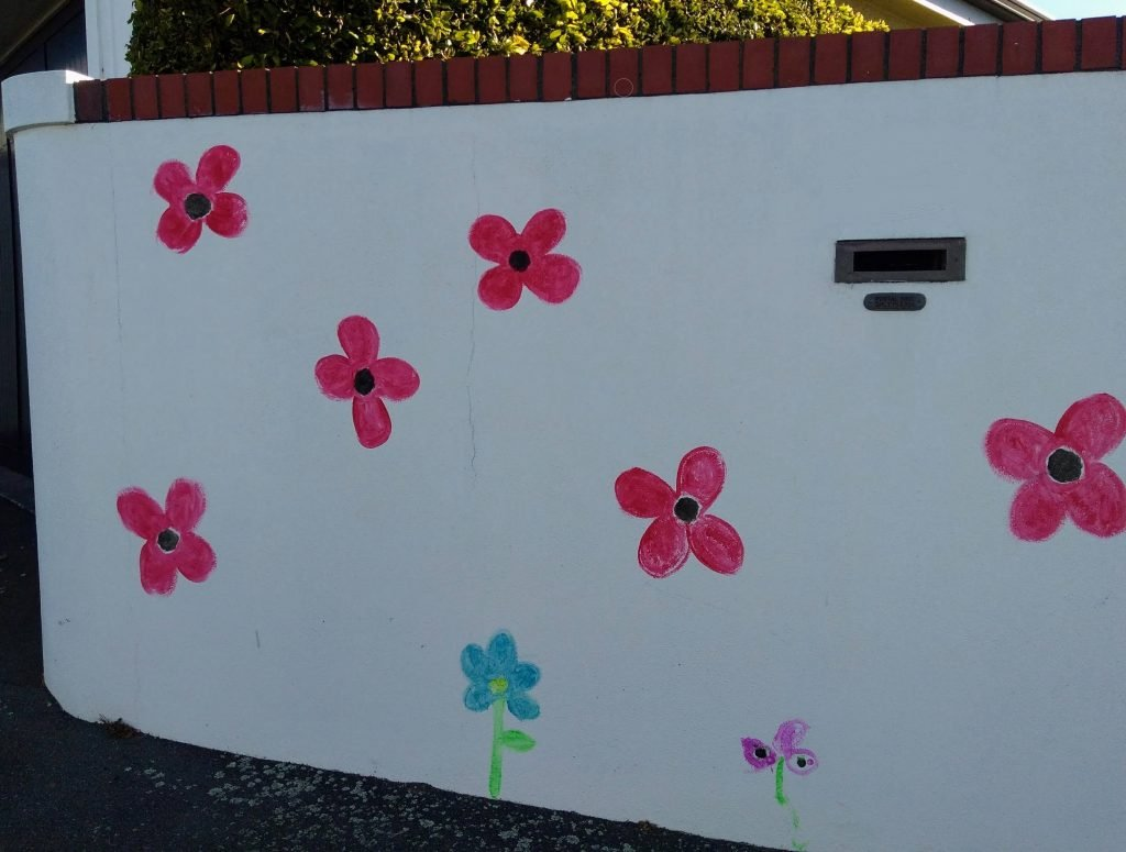 Flowers painted on a white garden wall
