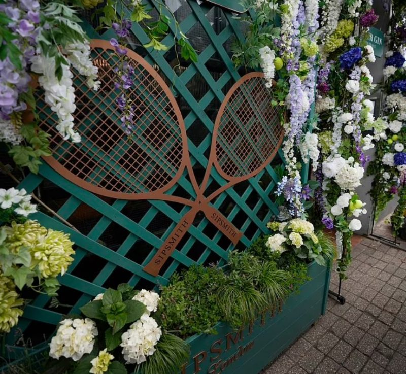 Tennis racquet and floral decorative display at the Fire Station pub in Wimbledon