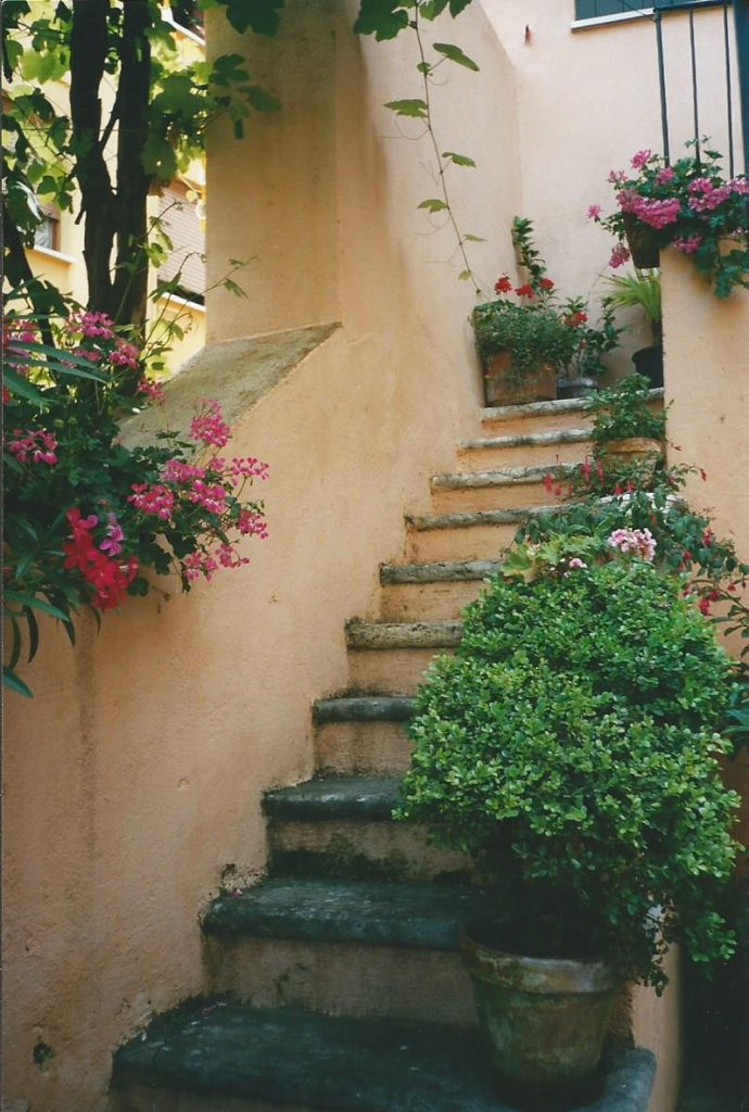 Stairway to a house in Gardone, Italy with flowers and shrubs