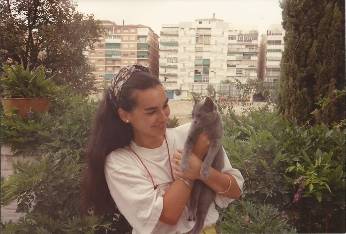 Girl and cat in the grounds of Huerta de San Vicente in Granada, Spain