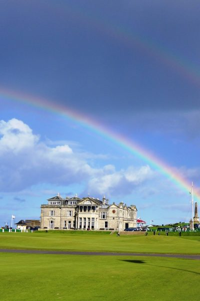 The Royal and Ancient Golf Club at St Andrews framed by a double rainbow