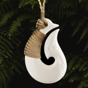 Bound matau pendant, Maori style hand carved in bone with traditional binding