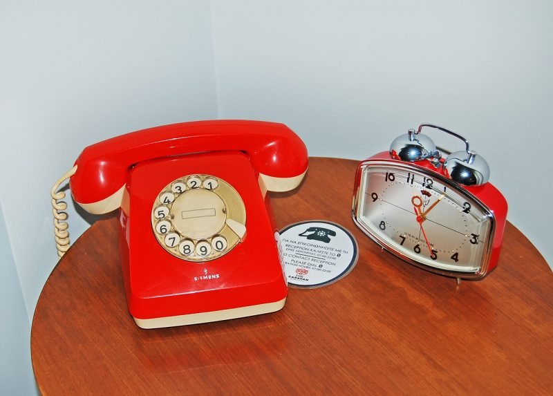 Old style hotel technology - rotary dial phone and alarm clock!