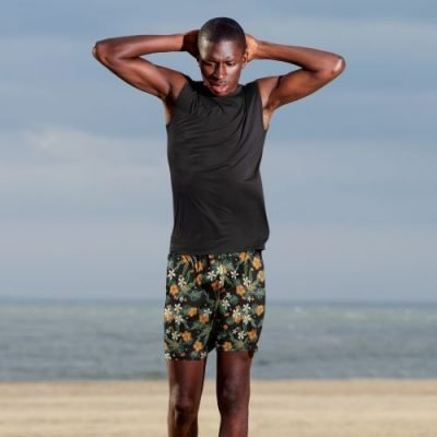 Men's athletic shorts in tropical print with flowers and leaves