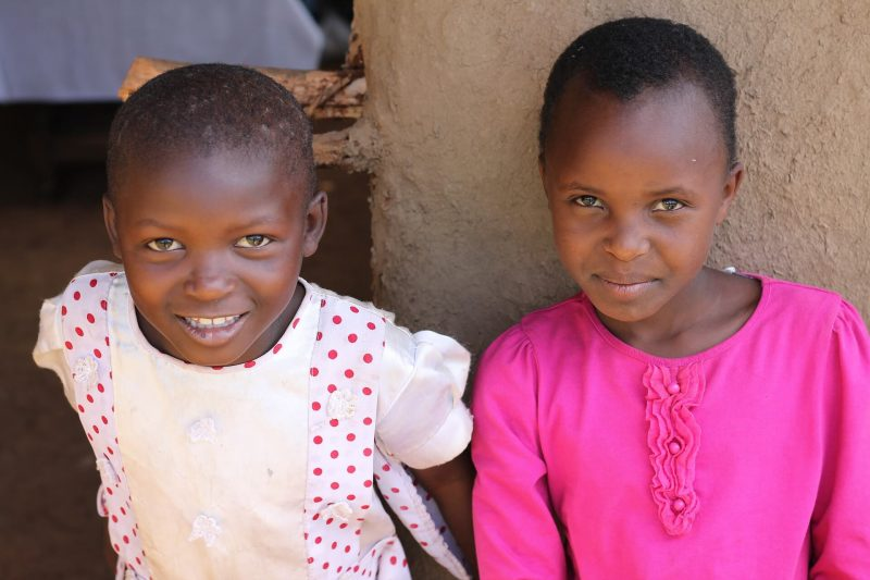 Eco-luxury tours often include work with children like these smiling girls in Africa