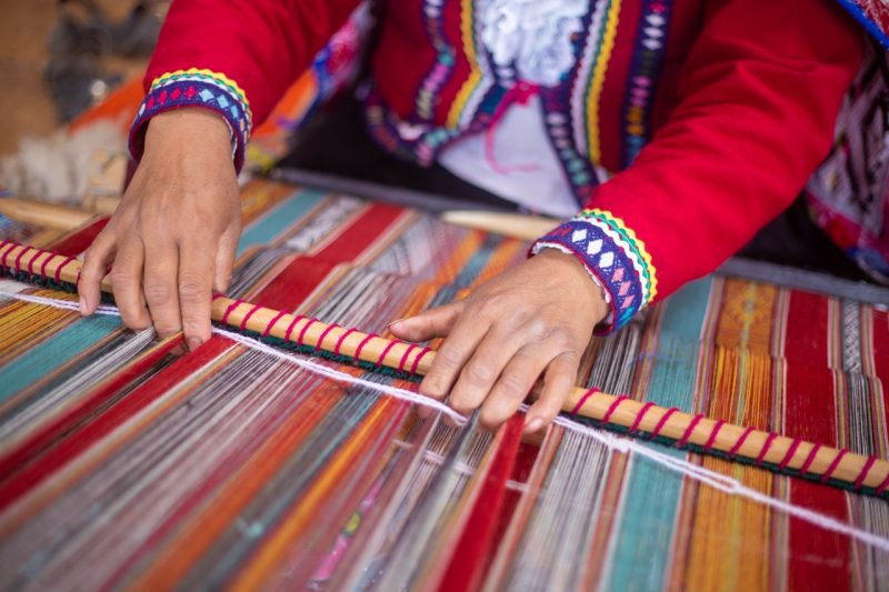 Traditional weaving on the loom in Peru