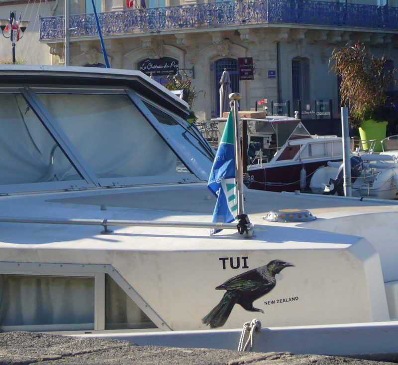 A boat called Tui from New Zealand moored at Marseillan, France