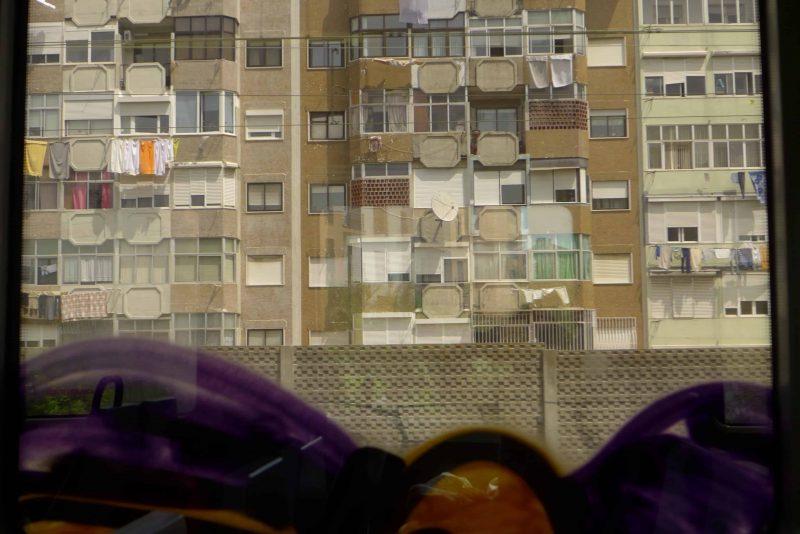 Apartment block seen through a train window, Lisbon, Portugal