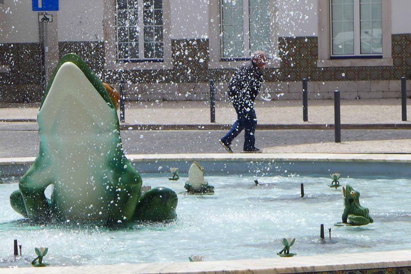 Caldas da Rainha - ceramic frogs and lilies in the fountain in front of the railway station. Made by Rafael Bordalo Pinheiro factory